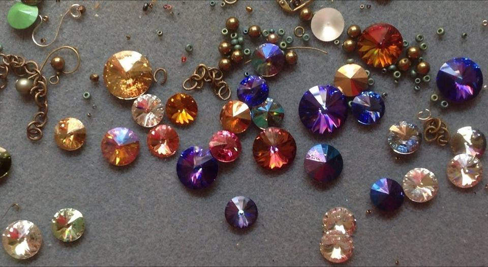 Future rivoli earring and necklace pieces scattered across Paula's work desk.