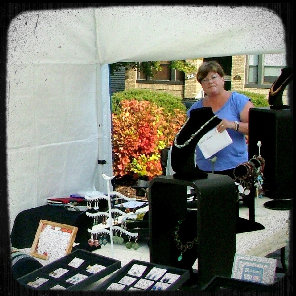 Jeanne Shuff of Jeanne Marie Jewelry setting up for a show.
