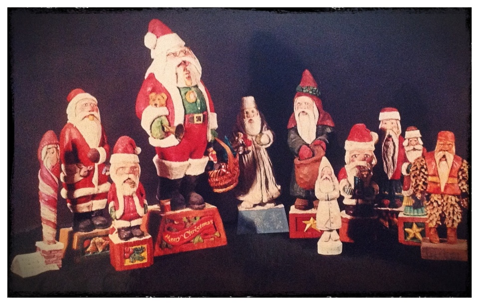 The Family Santas+, hand carved and painted by Ken Wagle.