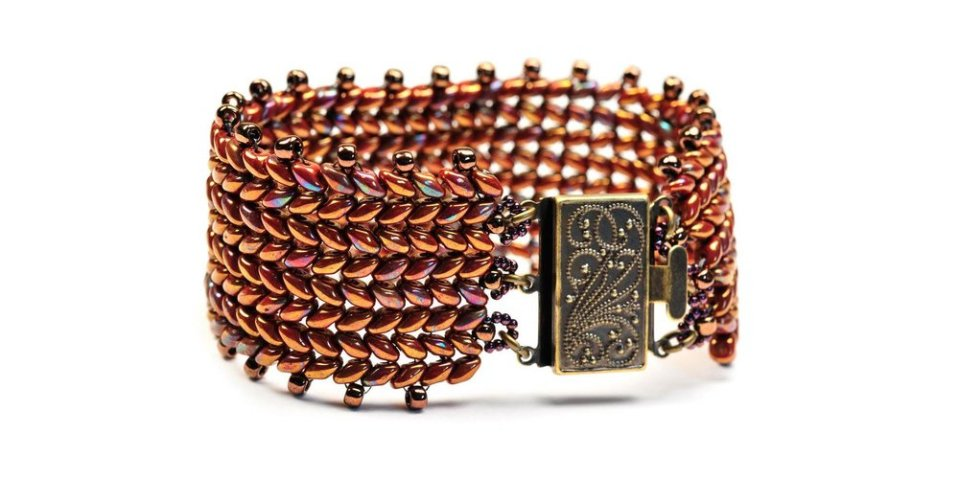 CLASS DESCRIPTION  This is part two of Olga's Beading Techniques Fall 2017 six-part series. You can enroll in one class or all six to become a true beader.  Learn an easy way to stitch wonderful two hole beads together to create an interesting herringbone pattern for this everyday bracelet. INSTRUCTOR  Award-winning artist, Olga Mihaylova | Oli's Beadwork. SKILL LEVEL  Beginner TUITION  $40  +  MATERIAL FEE  $15